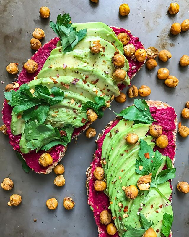 Avocado toast by @inspiredbynick •Toast: Classic sourdough •Beet infused hummus: ◦1 can of chickpeas ◦1 clove of garlic, crushed ◦1/4 cup of olive oil ◦1 medium sized beet, boiled ◦Juice of 1 lemon ◦1 tbsp water ◦1 tsp tahini ◦Salt & pepper to taste •1 fresh avocado, sliced •Topped with fresh parsley leaves, chili flakes & roasted chickpeas.